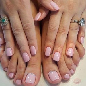 manicure and pedicure spa with pale pink colour and big toes gems design